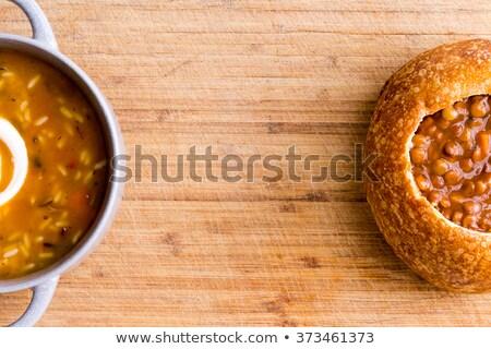 Partially hidden ceramic and bread soup bowls Stock photo © ozgur