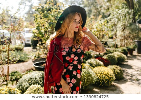beautiful blonde in red floral dress stock photo © feedough