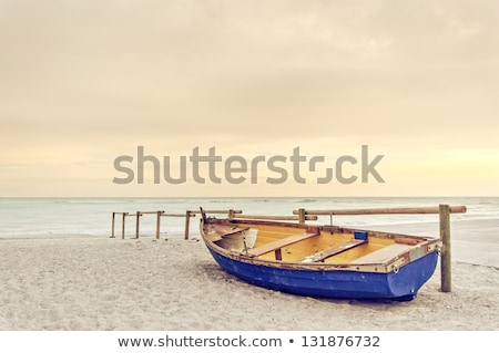 Beach With Old Boats Stock photo © PetrMalyshev