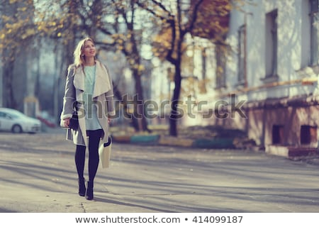 Beautiful young woman in autumnal city Stock photo © ssuaphoto