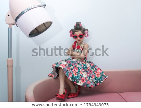 pretty young red hair woman in old -fashioned style room sitting smiling at window and typing machin Stock photo © iordani