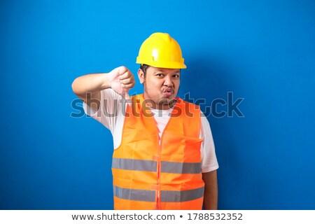 Rozczarowany asian budowniczy kciuk w dół Zdjęcia stock © RAStudio