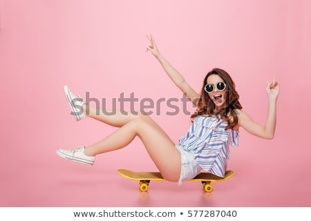 beautiful girl in sunglasses sitting Stock photo © tekso