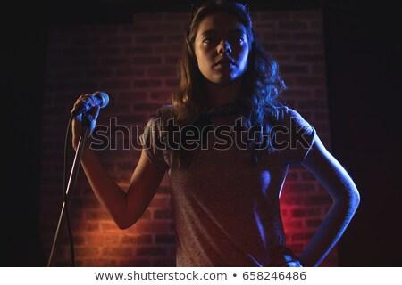 Kadın şarkıcı ayakta duvar gece kulübü kadın Stok fotoğraf © wavebreak_media