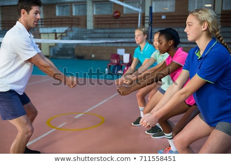 Volleyball players performing stretching exercise Stock photo © wavebreak_media