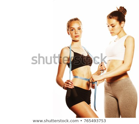 Young girls measuring themselves Stock photo © IS2