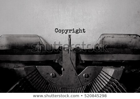 Copyright Symbol embossed on Paper Background.  Stock photo © olivier_le_moal