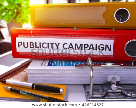 publicity campaign on red office folder toned image stock photo © tashatuvango