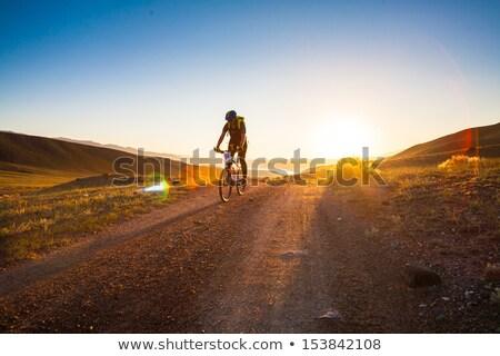 Hegy motoros elvesz naplemente sport sziluett Stock fotó © IS2