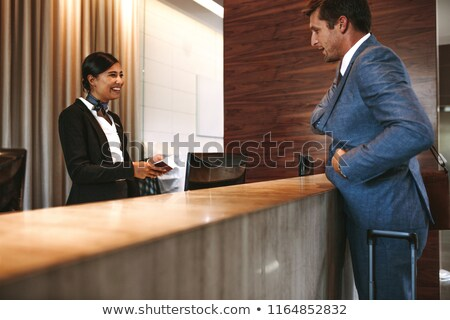 Businessman in front of checkin desk Stock photo © IS2