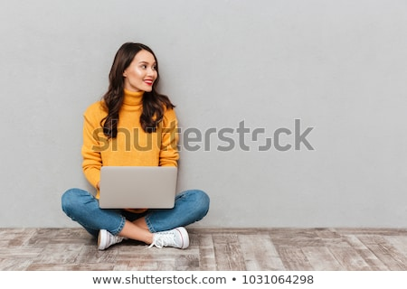 Portrait of a smiling girl looking away at copy space Stock photo © deandrobot
