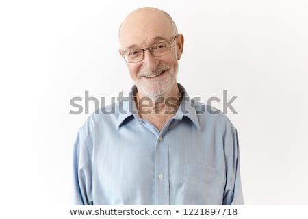 Studio portrait of balding senior man Stock photo © IS2