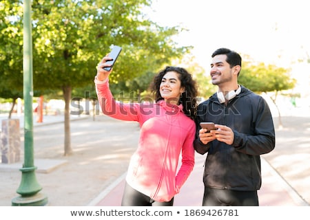 Photo of young fitness woman 20s in sportswear working out and s Stock photo © deandrobot