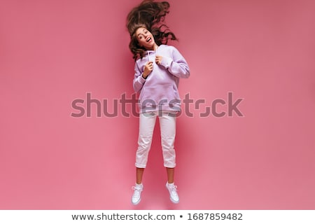 Full length portrait of joyful teen girl with curly hair in summ Stock photo © deandrobot