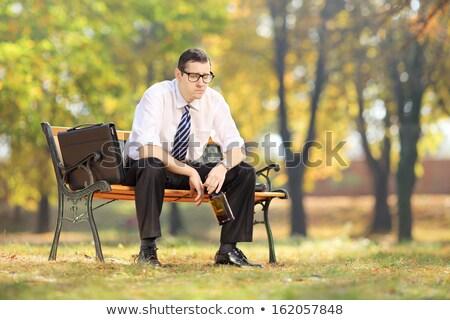 Deluso giovani imprenditore seduta panchina esterna Foto d'archivio © deandrobot