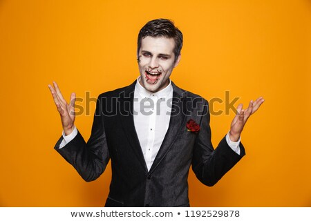 Photo of excited zombie man wearing groom suit and halloween mak Stock photo © deandrobot