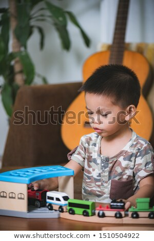 asian baby boy playing with toy blocks at home Stock photo © dolgachov