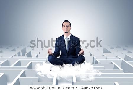 Stok fotoğraf: Businessman Meditates On A Cloud With Maze Concept