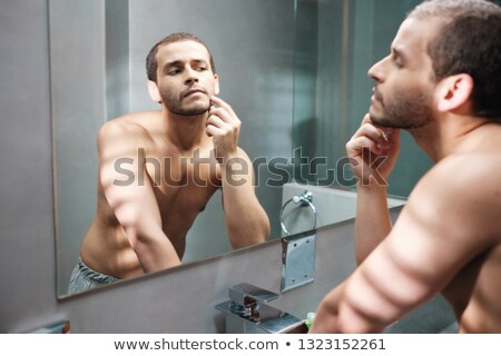 Gay Man Plucking Hair From Eyebrows For Body Care Beauty Stock photo © diego_cervo