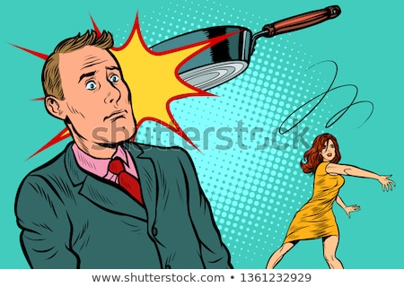 wife threw the griddle at her husband. family scandal Stock photo © studiostoks