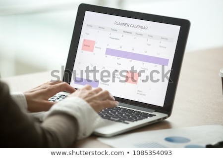 businesswomans hand checking schedule in diary stock photo © andreypopov