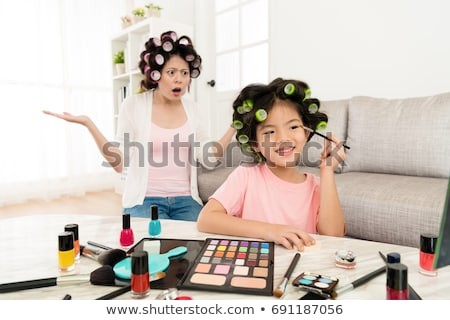 Shocked Mother Looking At Her Daughter Painting Face Stock photo © AndreyPopov