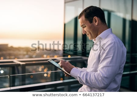 Confident businessman with graph. Stock photo © lichtmeister