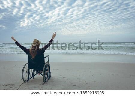 背面図 無効になって 女性 帽子 座って 車いす ストックフォト © wavebreak_media