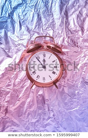 Christmas time on retro cooper painted alarmclock. Stock photo © artjazz