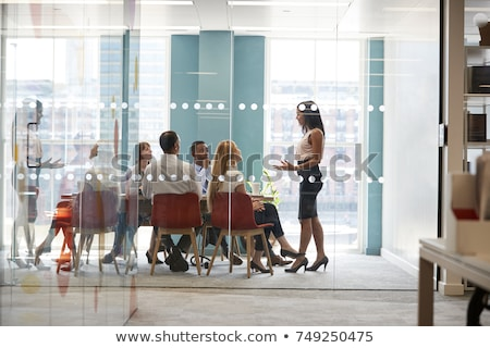 Side view of attentive Multi-ethnic business people working at desk in creative office Stock photo © wavebreak_media