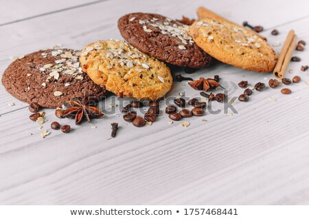 Fresh baked oat cookies heap on rustic wooden table. Stock photo © marylooo