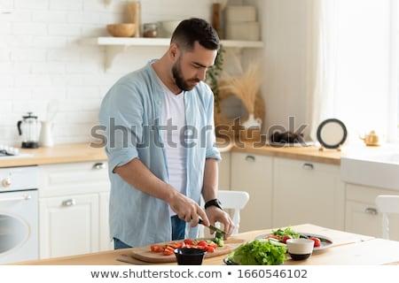 Fiatalember ételt készít konyha rusztikus étel főzés Stock fotó © boggy