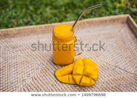 Mangó smoothie acél iszik szalmaszál üveg Stock fotó © galitskaya