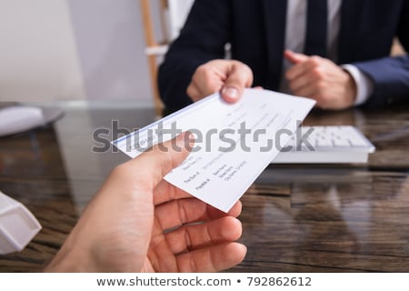 Giving Payroll Bank Paycheck To Employee Stock photo © AndreyPopov