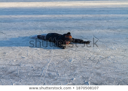 boy ice skating fell down on the ice rink Stock photo © galitskaya