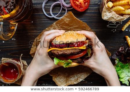 Delicious burger with red bun Stock photo © dash