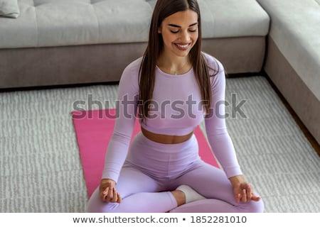 Mooie fitness vrouw vergadering kruis geschikt gezonde Stockfoto © darrinhenry