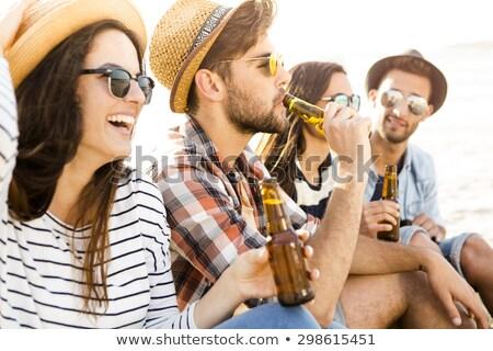 homem · água · potável · garrafa · praia · paisagem · moço - foto stock © photography33