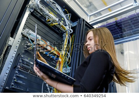 Young woman installing wiring Stock photo © photography33