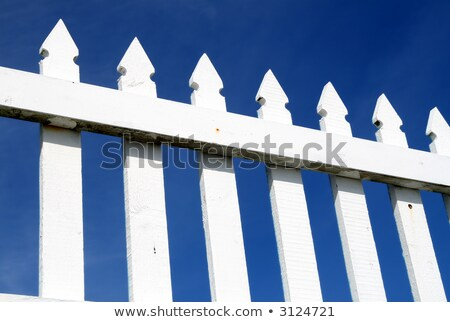 A white picket fence and a dark blue sky. Stock photo © latent
