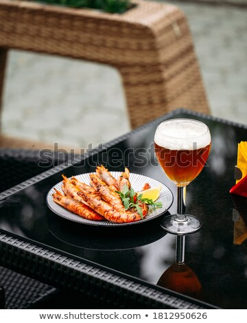 Beer into glass on table Stock photo © ozaiachin