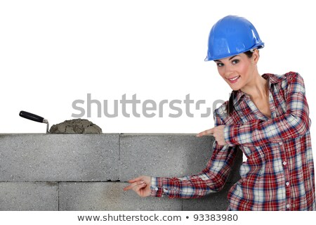 A female mason showing her work. Stock photo © photography33