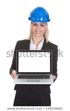 Female builder holding a laptop with a blank screen Stock photo © photography33