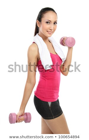closeup of a young woman using dumbbells stock photo © photography33