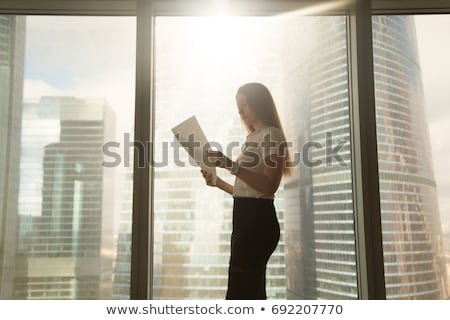 Corporate woman reading official documents Stock photo © stockyimages
