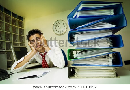 Depressed businessman surrounded with paperwork Stock photo © photography33
