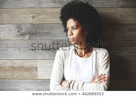 Young student girl in thoughtful posture. Stock photo © lithian