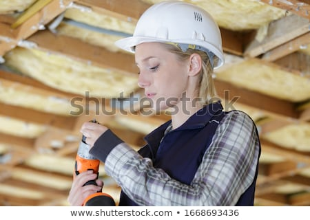 blond female builder holding cordless drill stock photo © photography33