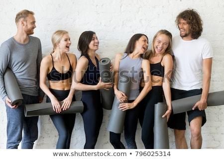 Aerobics pilates women group having a rest at gym stock photo © lunamarina