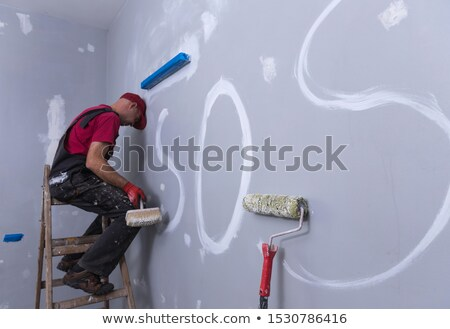 Tired builder resting against wall Stock photo © photography33